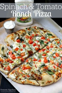 Spinach & Tomato Ranch Pizza ; definitely going to try these toppings on cauliflower pizza crust.
