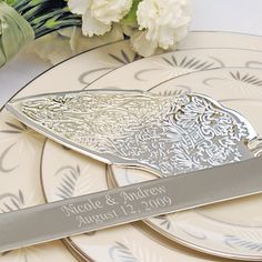 Nothing says romance like our beautiful Embossed Cake Serving Set.   Intricatelly detailed with a whimsical pattern, this cake knife and  server create a dreamy style all on their own.  The silver-plated pair  are sure to please with every piece of cake they slice and serve.  And  after they are personalized just for you, they are sure to become an  instant keepsake.  Details:Size: The cake knife measures 12 inches, and the cake server measures 9 inches long. Materials: Silver-plated setting