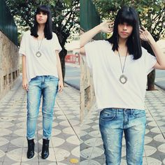 Reach for a white crew-neck t-shirt and light blue ripped jeans for a refined yet off-duty ensemble. Black leather booties will add elegance to an otherwise simple look. Shop this look for $52: http://lookastic.com/women/looks/white-crew-neck-t-shirt-and-silver-pendant-and-light-blue-jeans-and-black-ankle-boots/3629 — White Crew-neck T-shirt — Silver Pendant — Light Blue Ripped Jeans — Black Leather Ankle Boots