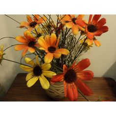 Silk flowers in clay jar/ vibrant colors in orange, red, yellow/terra... ($10) via Polyvore featuring home, home decor, floral decor, artificial flowers, flower arrangement, flower stem, terracotta pots and silk flower arrangement