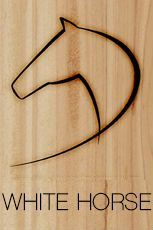 white horse saloon - branding iron logo on new wood