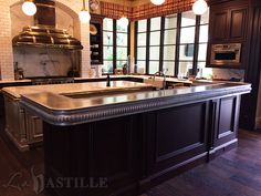 """The """"La Paix"""" pewter bartop is beautiful rounded corner bar and is the debut of our 5 1/2 inch edge profile that we quickly called """"La Paix."""" The top is finished with a high polish and a marine edge"""