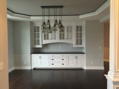 Dining room built-in buffet. Tray ceiling. Pottery Barn Paxton chandelier light.