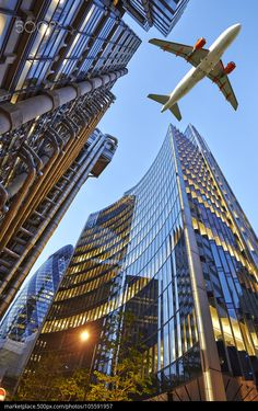 Cool pics - A jet plane flying over the city - by Bombaert Patrick