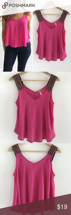 """Hot Pink Flowy Aztec Top Hot Pink Flowy Aztec Top! This top is perfect to throw over skinny jeans. Excellent condition. Super comfortable and flowy. Aztec printed straps. 100% polyester. Chest-36"""" length-21.5"""" size medium. Bella D Tops Blouses"""