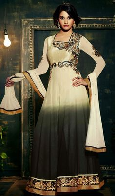 Revel in a feeling of stardom dressed in this cream and black shade chiffon georgette long Anarkali suit. The lovely lace and resham work a substantial feature of this attire.  #NewOutstandingLongAnarkaliDress