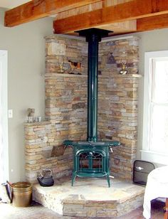 Husband is dead set on a wood stove in our future house someday. I think a fireplace looks better but I know they are useful. Wood Burning Stove Insert, Wood Burning Stove Corner, Wood Stove Surround, Wood Stove Hearth, Stove Fireplace, Wood Burner, Fireplace Design, Corner Stove, Hearth Pad