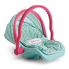 Bitty's Travel Seat  Item# V8085  Bitty Baby can travel in comfort with this cushy seat, featuring a lap belt to keep her safe, a collapsible sunshade with furry trim, and a handle that folds up for easy carrying.   $42