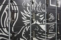 University of South Carolina's football team equipment room. The main focal point, both aesthetically and in terms of usability, is a bank of Foreman lockers featuring Wilsonart® Compact Laminate with the USC Gamecock logo.