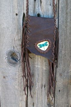 Hey, I found this really awesome Etsy listing at https://www.etsy.com/listing/99224782/leather-crossbody-bag-beaded-dragonfly