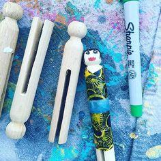 Wee Warhols making peg dolls using clothes pins and washi tape.