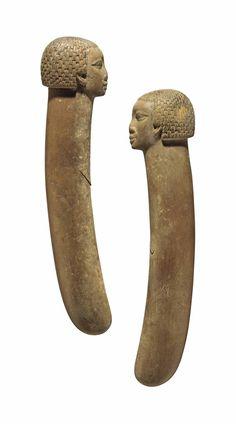 A PAIR OF EGYPTIAN WOOD CLAPPERS - MIDDLE KINGDOM-NEW KINGDOM, 12TH-18TH DYNASTY, CIRCA 1985-1295 B.C.