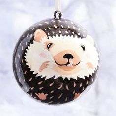 Decorate your tree with this adorable painted hedgehog ornament!