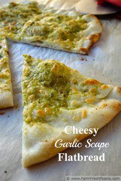 Garlic Scape Pesto Cheesy Flatbread Pizza   Farm Fresh Feasts http://www.farmfreshfeasts.com/2014/05/garlic-scape-pesto-cheesy-flatbread.html