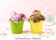 ice cream in metal cup on kitchen table background