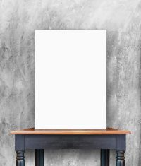 blank poster on vintage wooden table at concrete wall stock photo