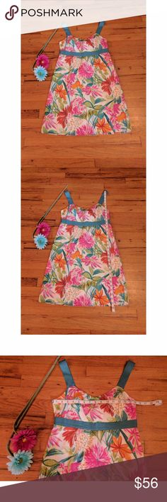 Tommy Bahama Floral Tropical Sleeveless Dress Tommy Bahama Floral Tropical Sleeveless Dress in excellent used condition!  This dress is a cotton/silk blend with a 100% cotton lining. It's incredibly lightweight and perfect for a summer evening walk along the beach!! It has a side zipper closure. Smoke free home. Tommy Bahama Dresses Mini