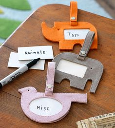 Make Luggage tags as labels for child's room storage.  Cute and clever! Could do in felt.