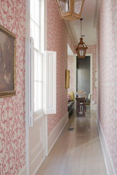 Lovely pink wallpapered hallway ... <3