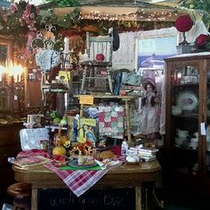 Beautiful display of antiques and vintage goodies in booth 134 at the Brass Armadillo (816) 847-5260...They ship stuff!