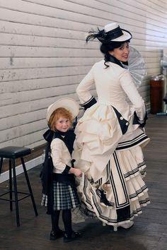 1880's Bustle black & white dress. The little girl is so cute