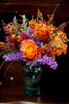 Purple and orange pretty mason jar centerpieces