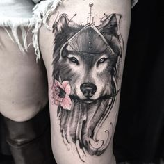Pink Flower In Wolf Head Tattoo On Left Thigh