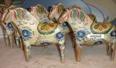 Copies of an old Dala horse, the original to the right