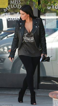 Glamourpuss: Kardashian finished off her casual daytime look with suede peep-toe booties, waist-length hair extensions, and false lashes