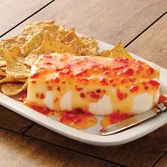 SweetChiliCreamCheese Dip.  Just tried new Frank's RedHot Sweet Chili Sauce. GAWD it is GOOD!