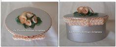 Scatola in cartone ovale cm 12x6,5x6,5 trattata con acrilico argento e decorata con fiorellini in pasta di mais e passamaneria