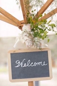 #chalkboard, #welcome  Photography: Josh Gruetzmacher Photography - joshgruetzmacher.com Floral Design: Grass Roots - grassrootssantabarbara.com  Read More: http://www.stylemepretty.com/2012/08/27/santa-barbara-wedding-at-orella-ranch-from-josh-gruetzmacher-photography/