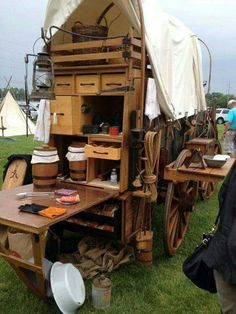 """Old school integrated """"trailer"""" camp kitchen. Notice the clever removable wheel side table Camping Tent Decorations, Glamping, Bushcraft, Camping Table, Camping Kitchen, Camping Cooking, Horse Drawn Wagon, Wooden Wagon, Chuck Box"""