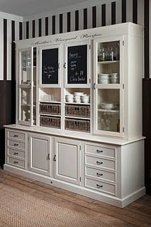 """perhaps the back wall could be white """"built ins"""" and then replace the entertainment center with something lower profile"""