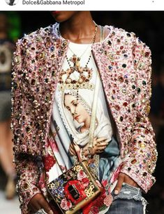 Massive appliques on a jacket. Beautiful trims on the whole garment. 12/05/2016