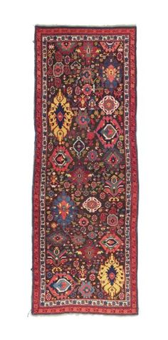 KUBA RUG EAST CAUCASUS, MID 19TH CENTURY Of Harshang design, naturally corroded brown, a few minute repairs, overall good condition 8ft.4in. x 3ft.1in. (254cm. x 93cm.)