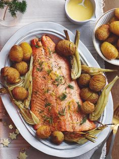 If you're hosting a festive dinner party or want something other than turkey on Christmas Day, try this zesty roast salmon. Look like a pro chef by pairing with a rich beurre blanc and crisp hasselback potatoes (a twist on classic roasties). Easy Thanksgiving Dinner, Easy Christmas Dinner, Thanksgiving Side Dishes, Holiday Dinner, Thanksgiving Recipes, Christmas Dinners, Winter Holiday, Christmas Recipes, Christmas Holiday