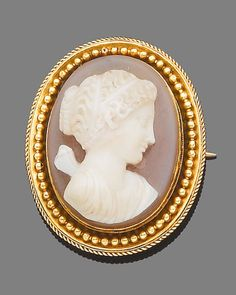 A hardstone cameo brooch, circa 1860 The oval hardstone plaque carved to depict Psyche facing left, within a gold mount with alternating ropetwist and beadwork detail, length 4.9cm.