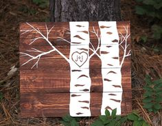 Havent you seen a heart carved in a tree and thought it was so romantic? Or seen it on a movie and thought, I wish someone would do that for me! Well now you can have it hanging in your home and you dont need to trek through the forest to see it everyday!  This one of a kind wood sign would look great in any home as a piece of art but also a symbol of love featuring two aspens with a heart in tree with couples initials and a special date (wedding, first kiss etc.)  Each piece is hand…