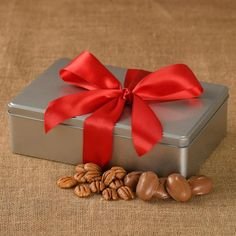 Our classic Sweet and Salty gift tin contains both our Chocolate Drenched Pecan Halves and our Toasted & Salted Pecans for a tempting combination. Chocolate Liquor, Chocolate Shop, Georgia Pecans, Pecan Nuts, Pecan Recipes, Tin Gifts, Tree Nuts, Delicious Chocolate, Sweet And Salty
