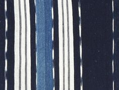 Adire African Textiles - Ikat motifs were a speciality of women weavers in the town of Igara near Okene. This example combines imported white cotton stripes with local indigo dyed hand spun cotton.