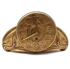 Bronze Amsterdamse School pendulum with stylised decoration design attributed to Theo van Reijn 1884 - 1954 ca.1920