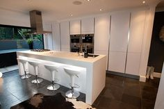 Handleless kitchens from LWK Kitchens - White handleless German kitchen - Discover more at www.lwk-home.com