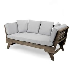 Transform your outdoor space into a cozy oasis with this cushioned daybed. Made from sturdy acacia wood with water-resistant cushions, this cozy outdoor couch can withstand the elements and still be in shape for years. The soft gray color of the cush Outdoor Daybed, Outdoor Lounge Furniture, Outdoor Decor, Outdoor Living, Outdoor Ideas, Patio Daybed, Pool Furniture, Outdoor Sectional, Outdoor Rooms