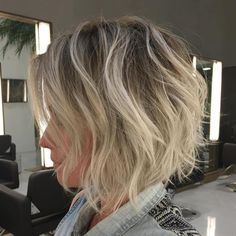 Shaggy Blonde Balayage Bob With Root Fade. Volume created by wispy texture and bleached pieces over dark base