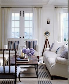 Victoria Hagan designed living room: love the all-white furniture, white drapes with simple iron curtain rods