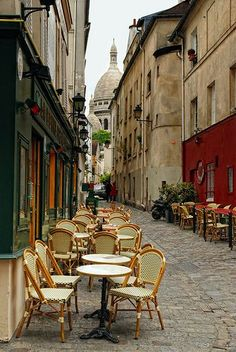 streetside tables at a cafe in montmartre, paris
