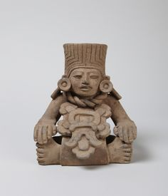 Early Classic (Monte Albán III-A), Zapotec  Anthropomorphic urn ('companion' type), A.D. 250–500  Gray clay, brown on surface, very micaceous .Place made: Isthmus of Tehuantepec, Oaxaca, Mexico.