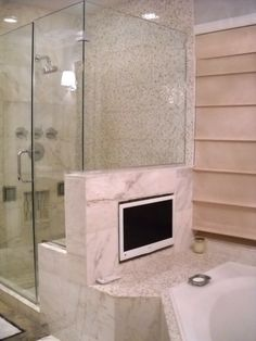 Remote-Controlled TV, Stereo or Windows - Electronics that work at the touch of a button make bath time more fun.