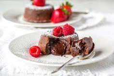 Molten Chocolate Cake -famous for it's tender, moist cake, a light crispy crust, and gooey rich chocolate middle. www.savingdessert.com